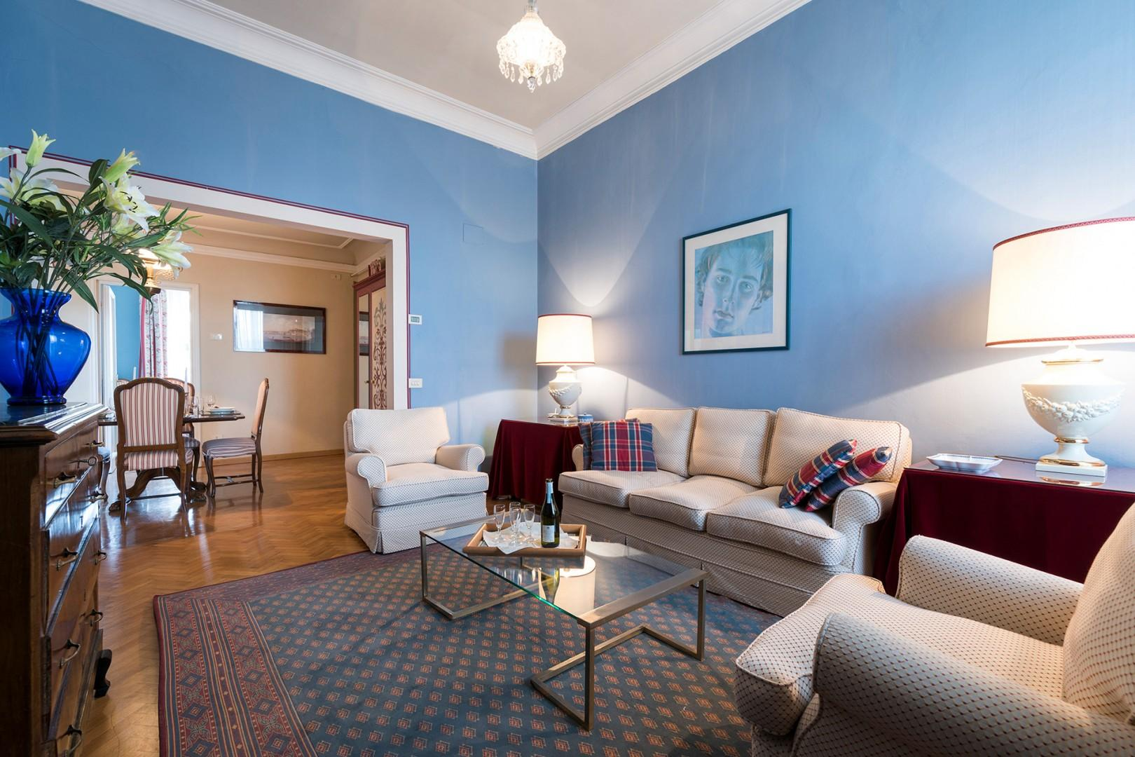 Tastefully appointed, the living room has large windows that overlook the Arno River.