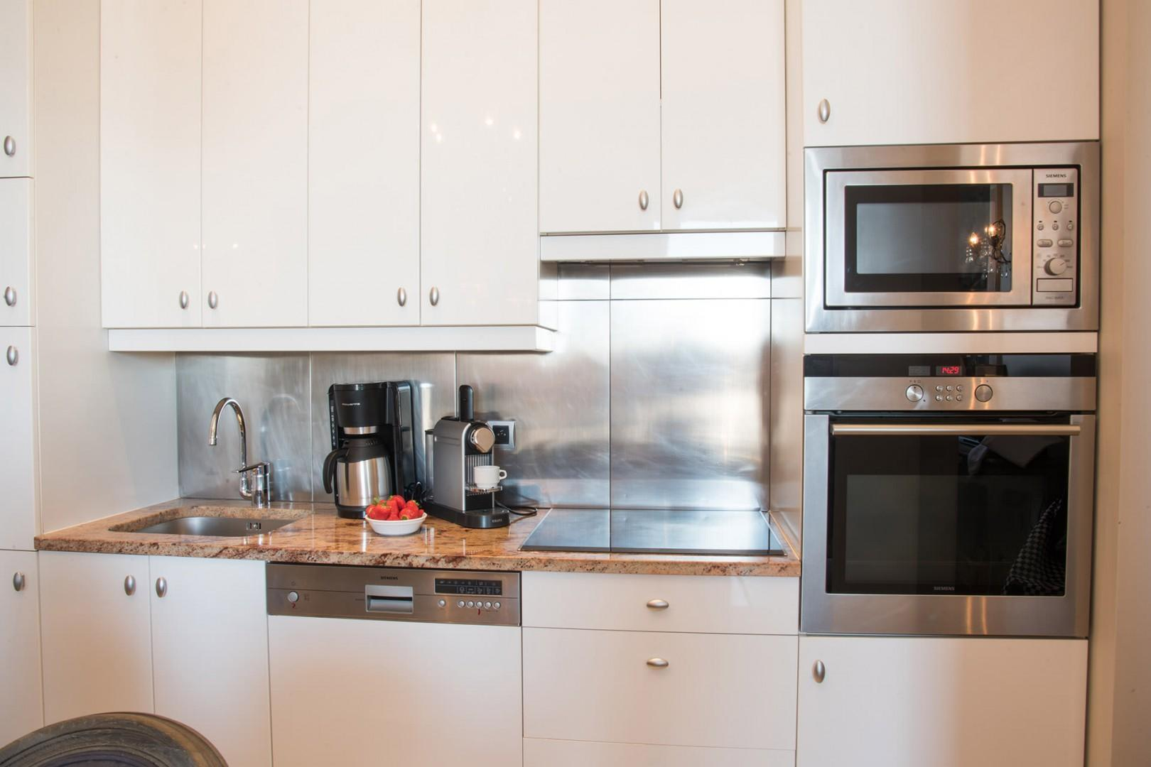 The modern and stylish kitchen is fully equipped with everything you need.
