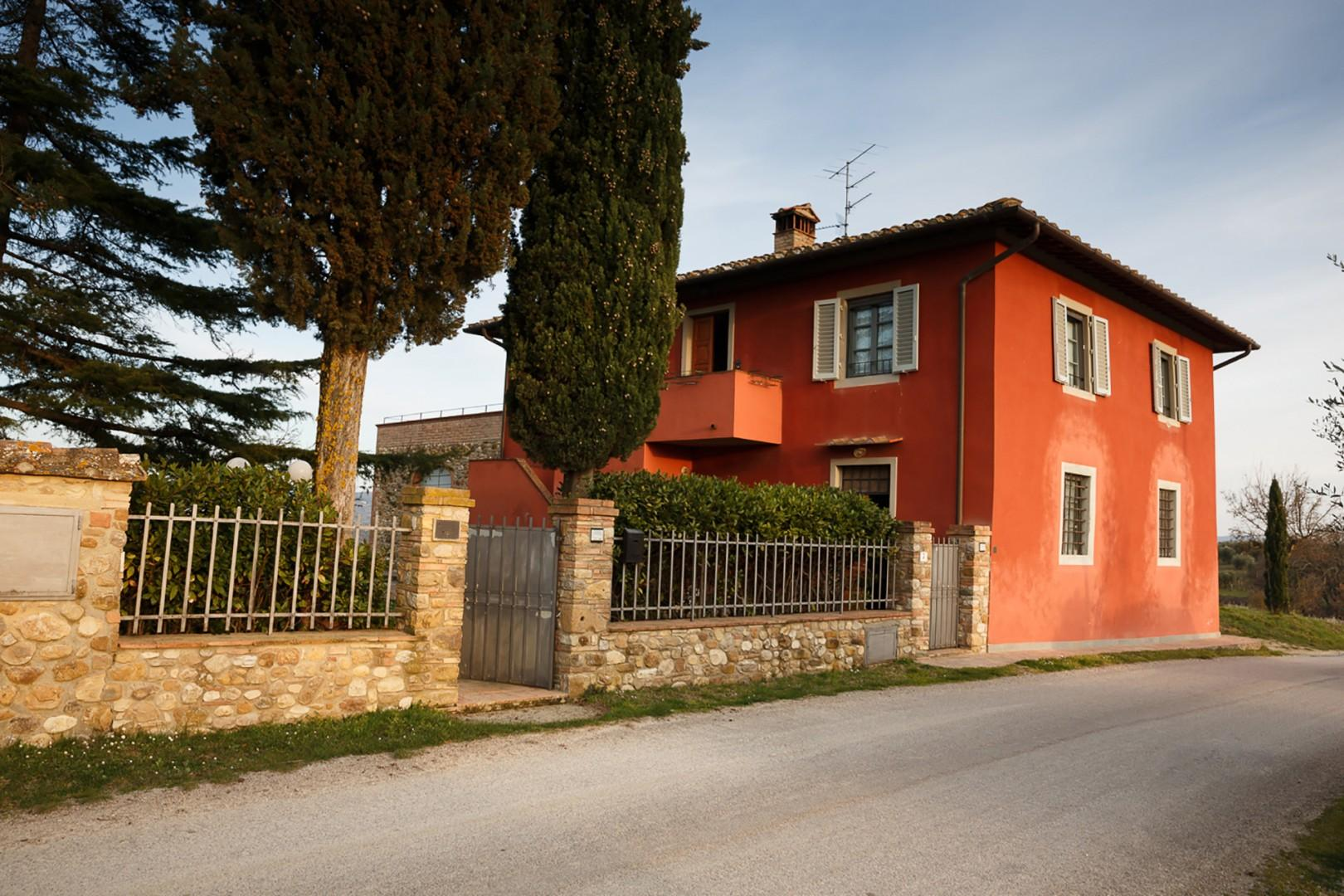 """The aptly named Casa Rossa or """"Red House"""" is a restored farmhouse painted in warm red tones."""