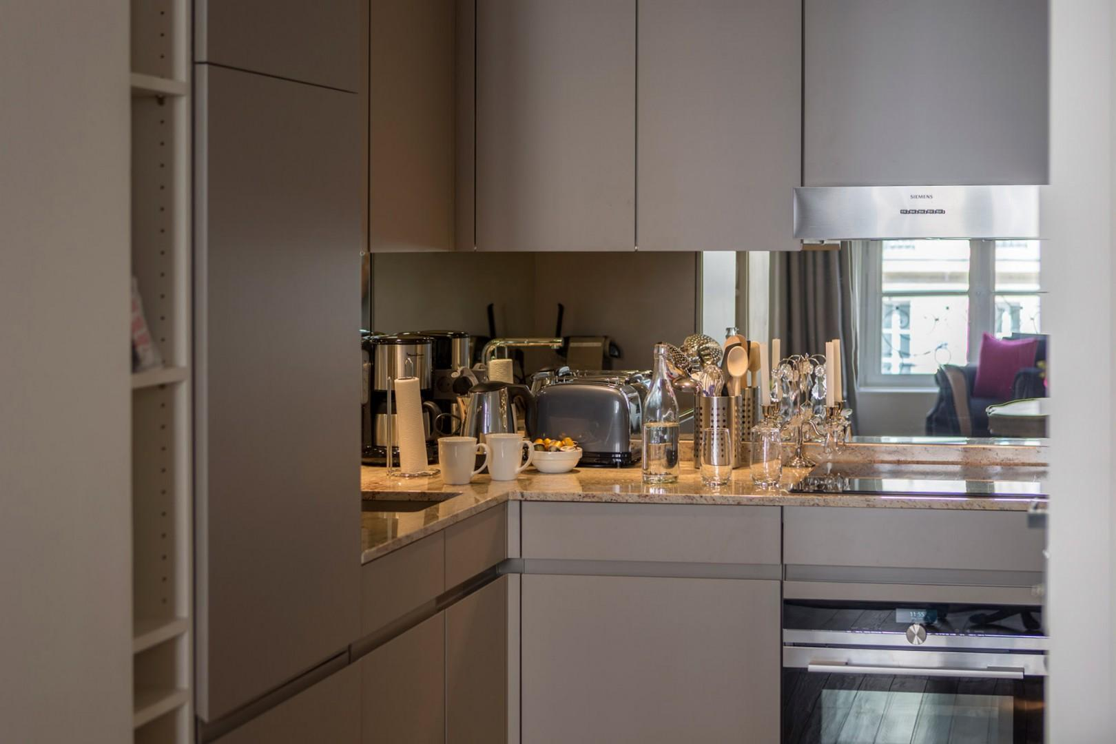The fully equipped kitchen has top-of-the-line appliances.