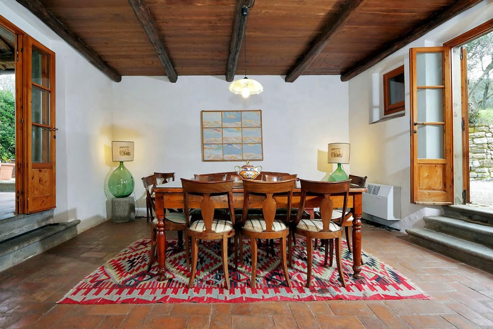 The country style dining room at Villa Poggio seats eight.