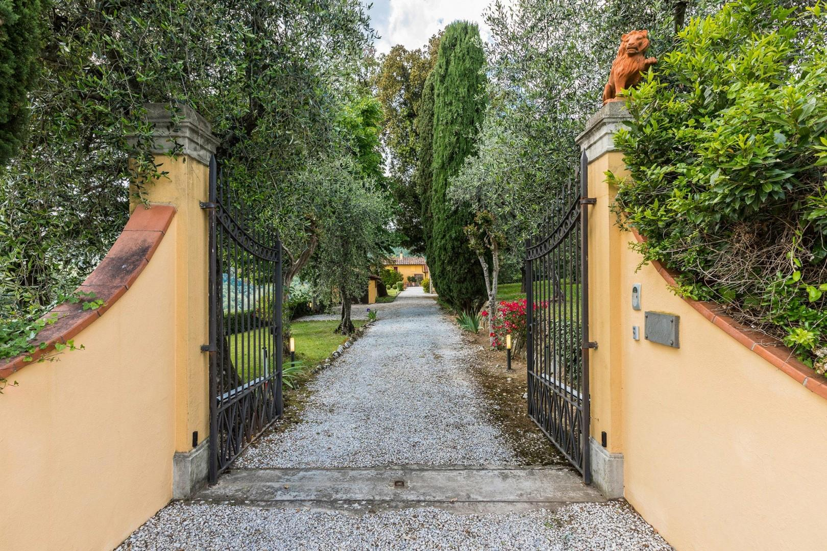 This private estate has a gate and is fenced.