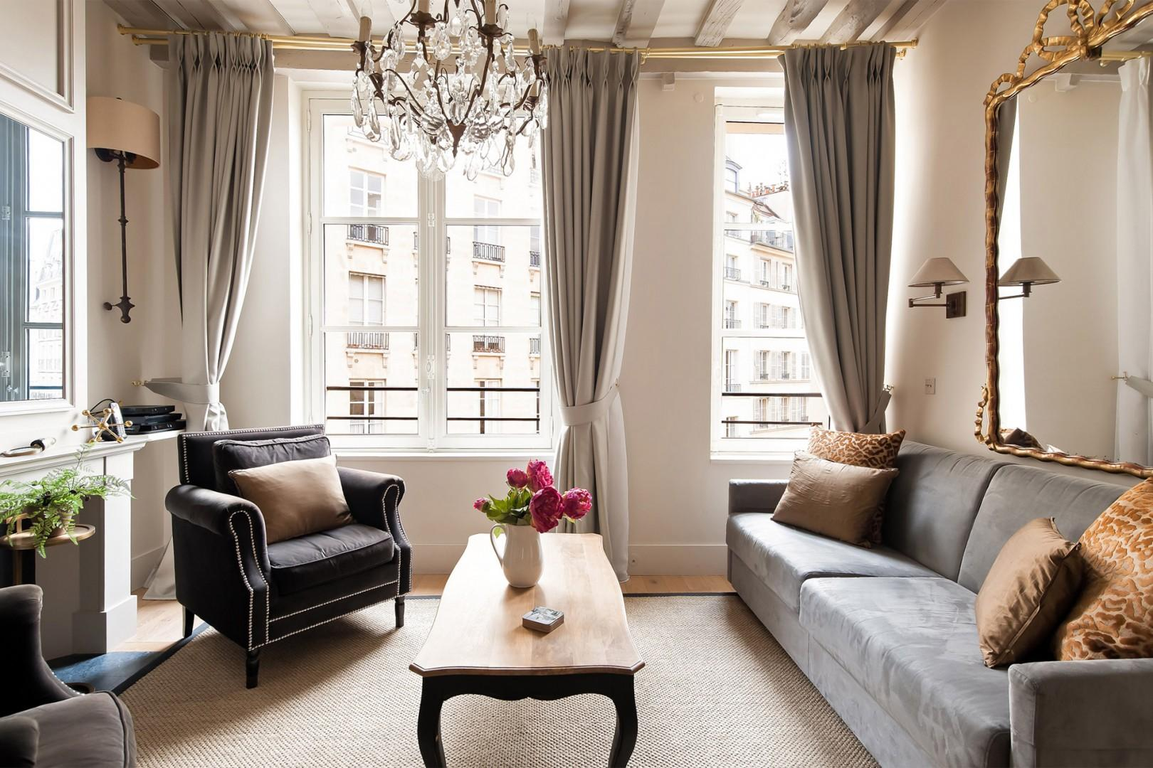 Relax in the style between sightseeing trips in this comfortable living room.