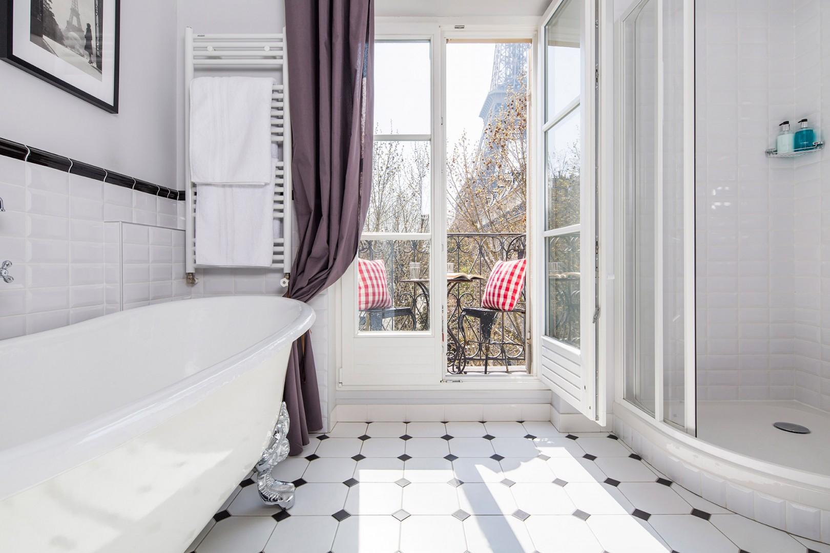 Look at this spectacular bathroom with claw foot tub and Eiffel Tower views!