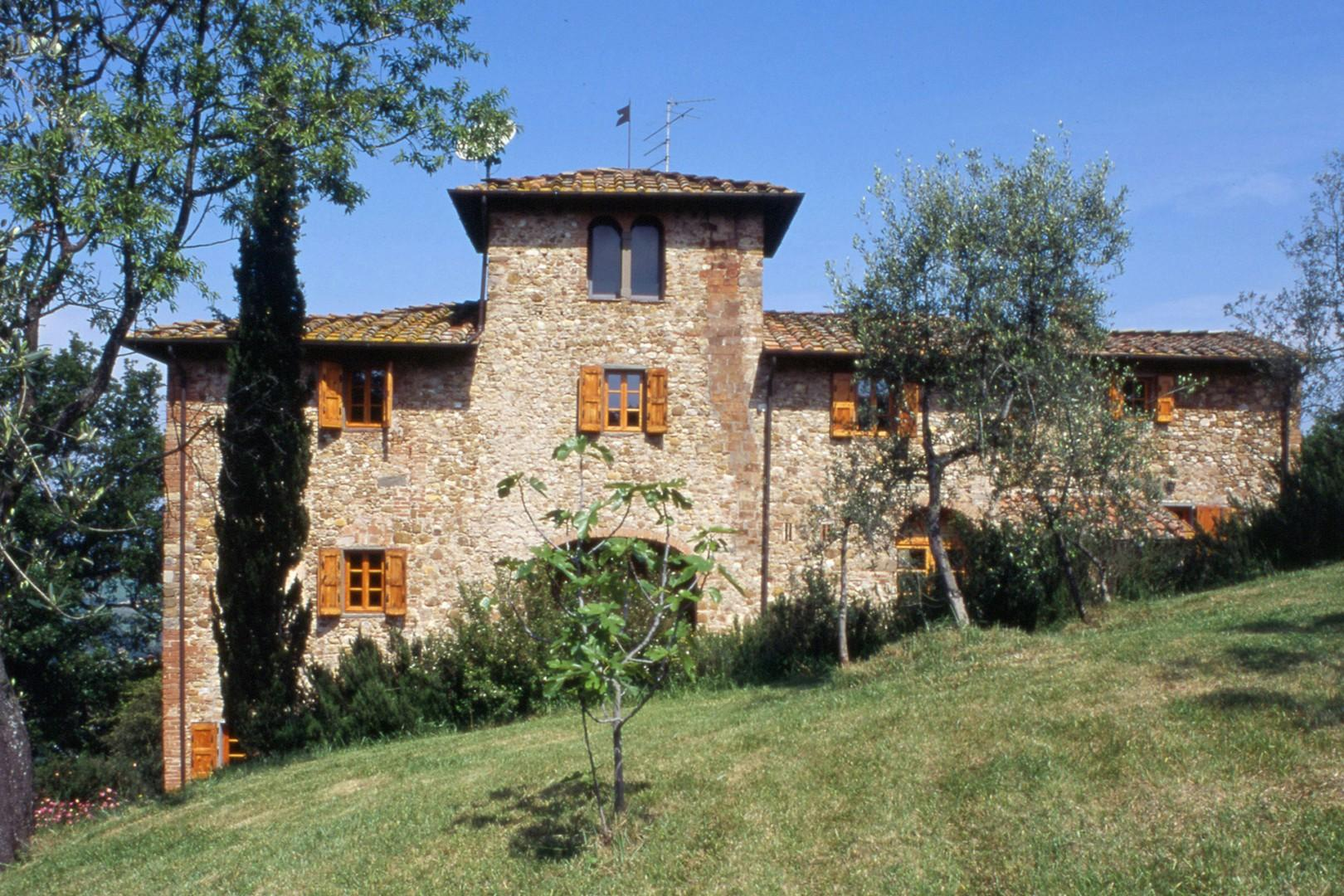 The villa is on a hill. Here you can see 2 floors and the arch of the terrace, off the dining room.