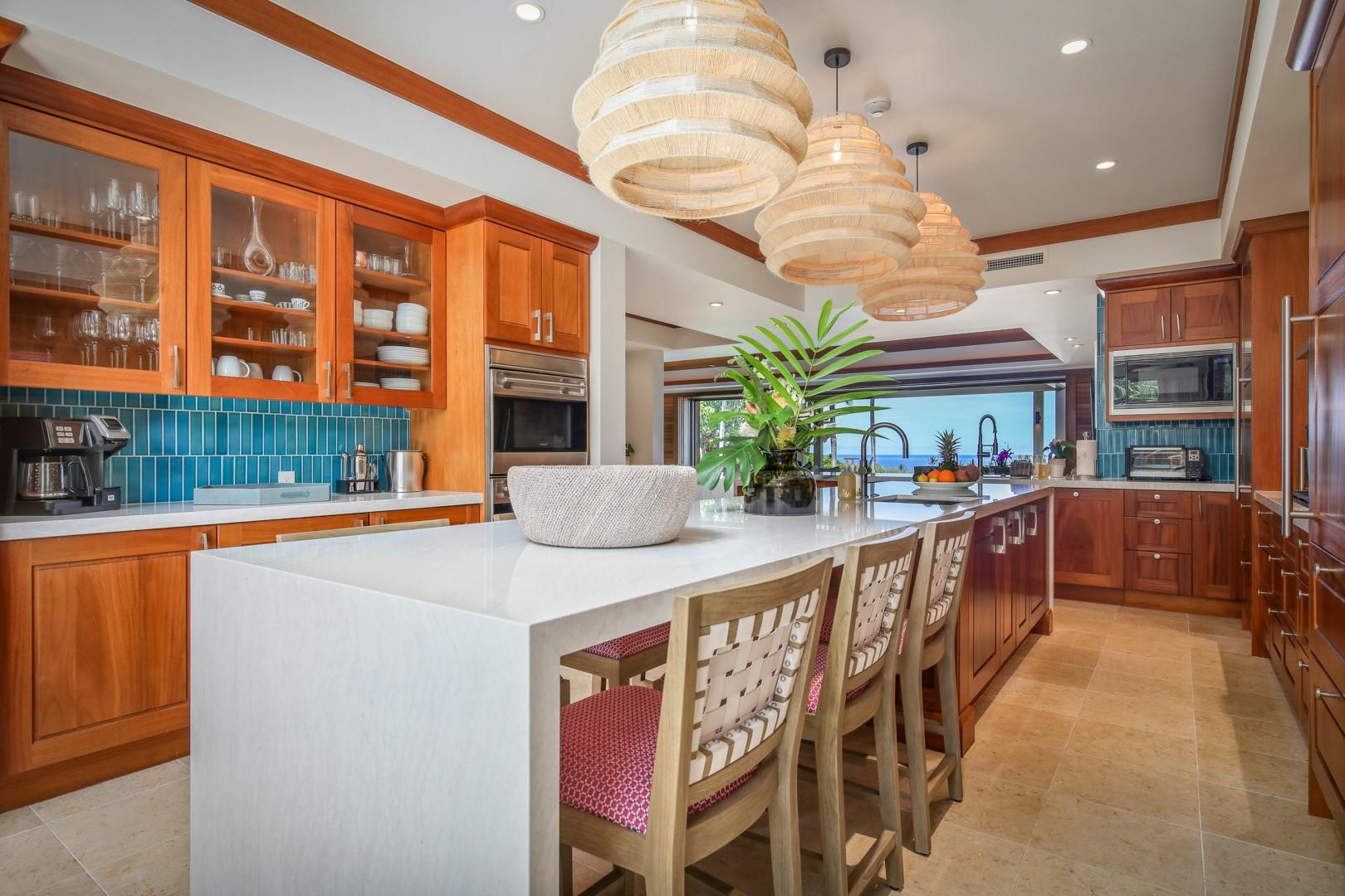 Spacious open concept kitchen with center island and bar seating.