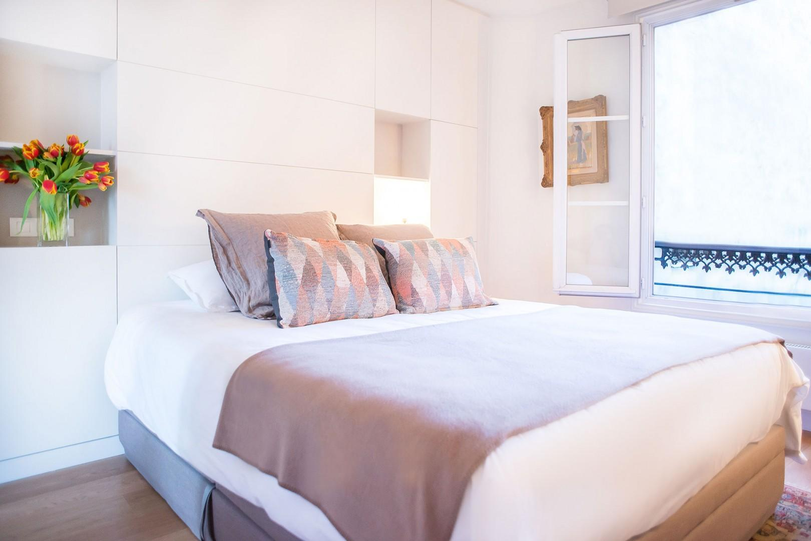 Relax in the elegant private bedroom with an en suite bathroom.