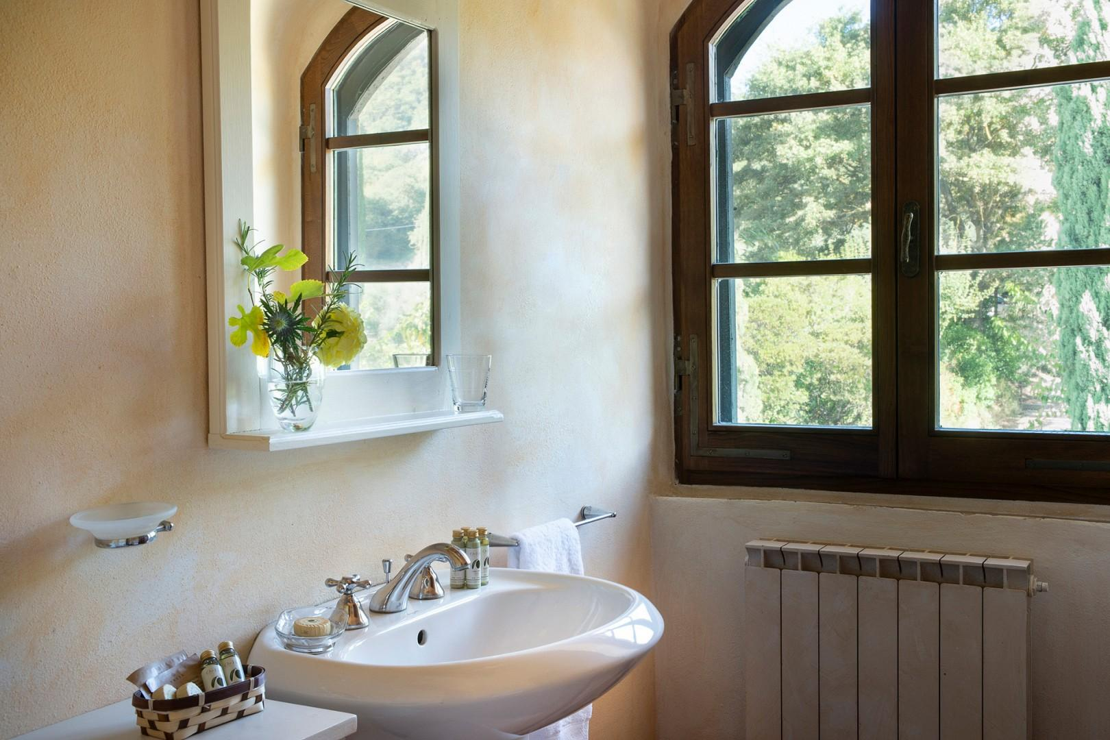 Bathroom is fitted with a bathtub, shower, sink, toilet and bidet.