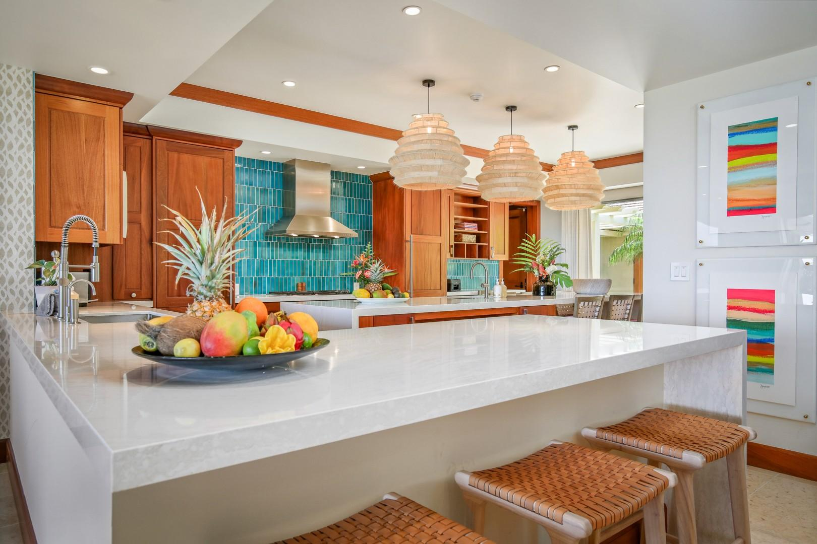 Top tier appliances throughout, this generous kitchen is the perfect hub for this flawless home.