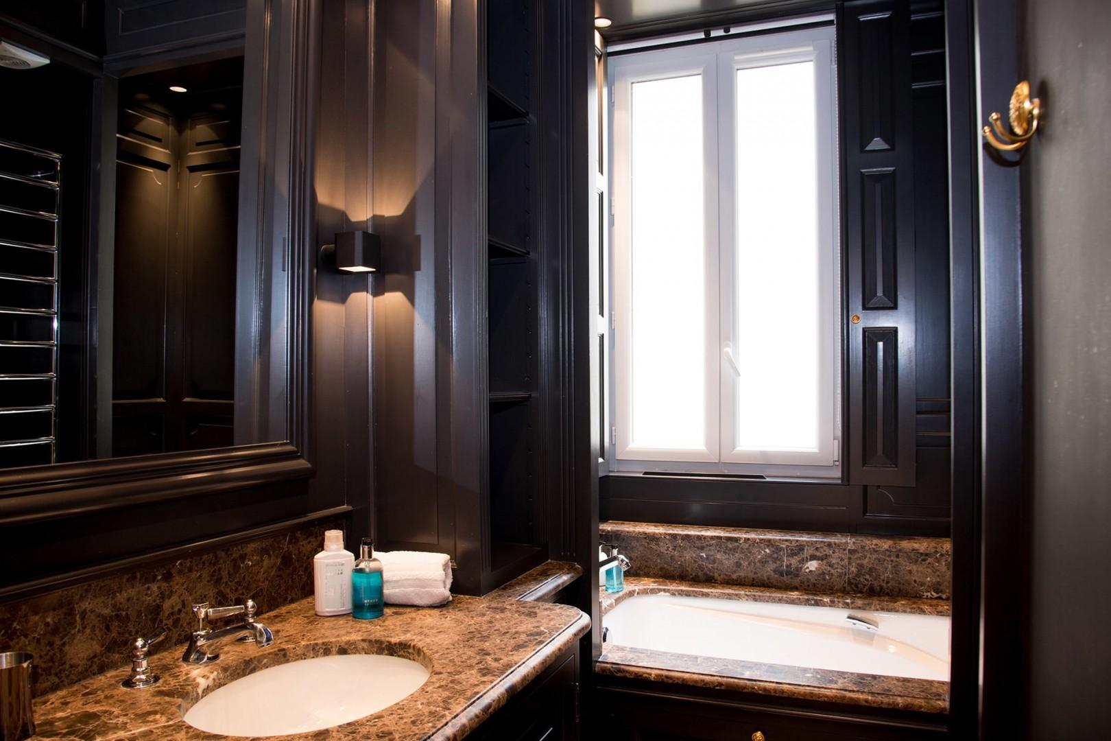 Indulge in the luxurious comfort of bathroom 1.