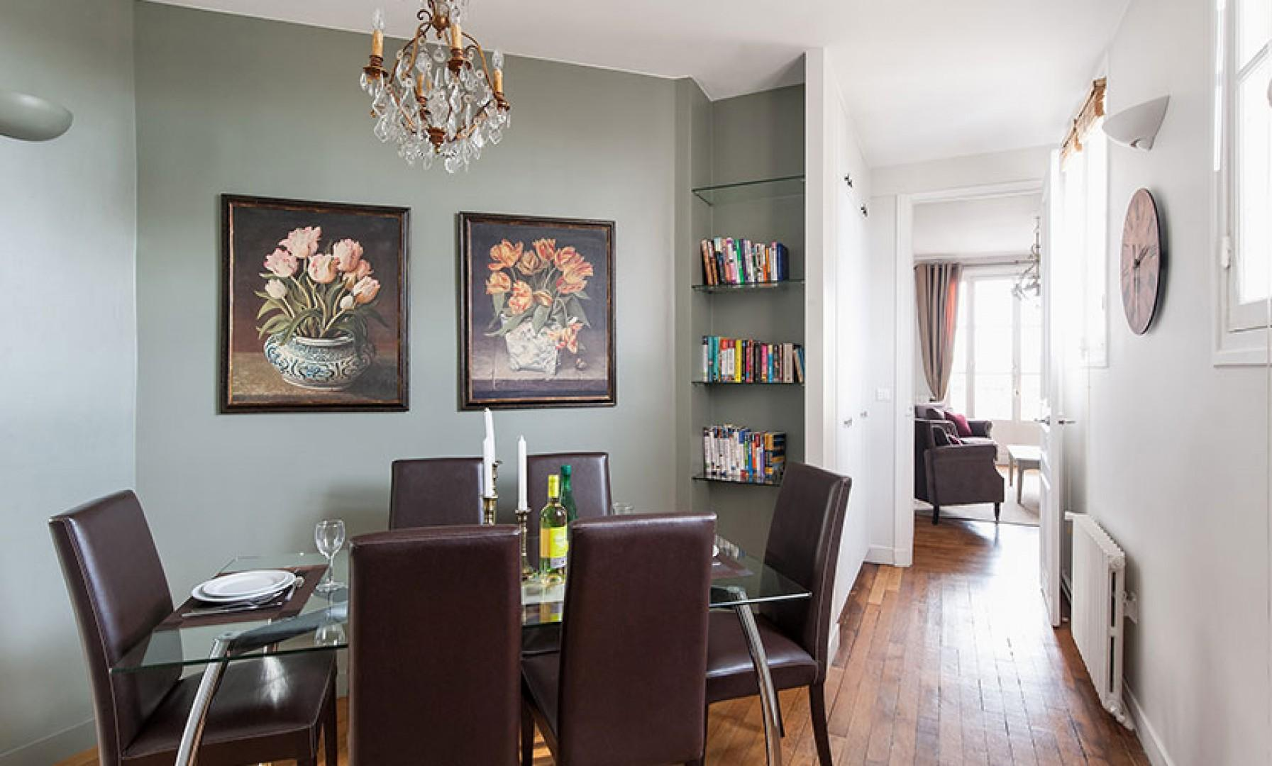 The comfortable dining area is conveniently set near the kitchen.