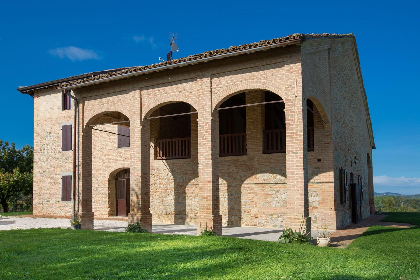 The front of the building has a covered terrace that mirrors the one on the back of the villa.