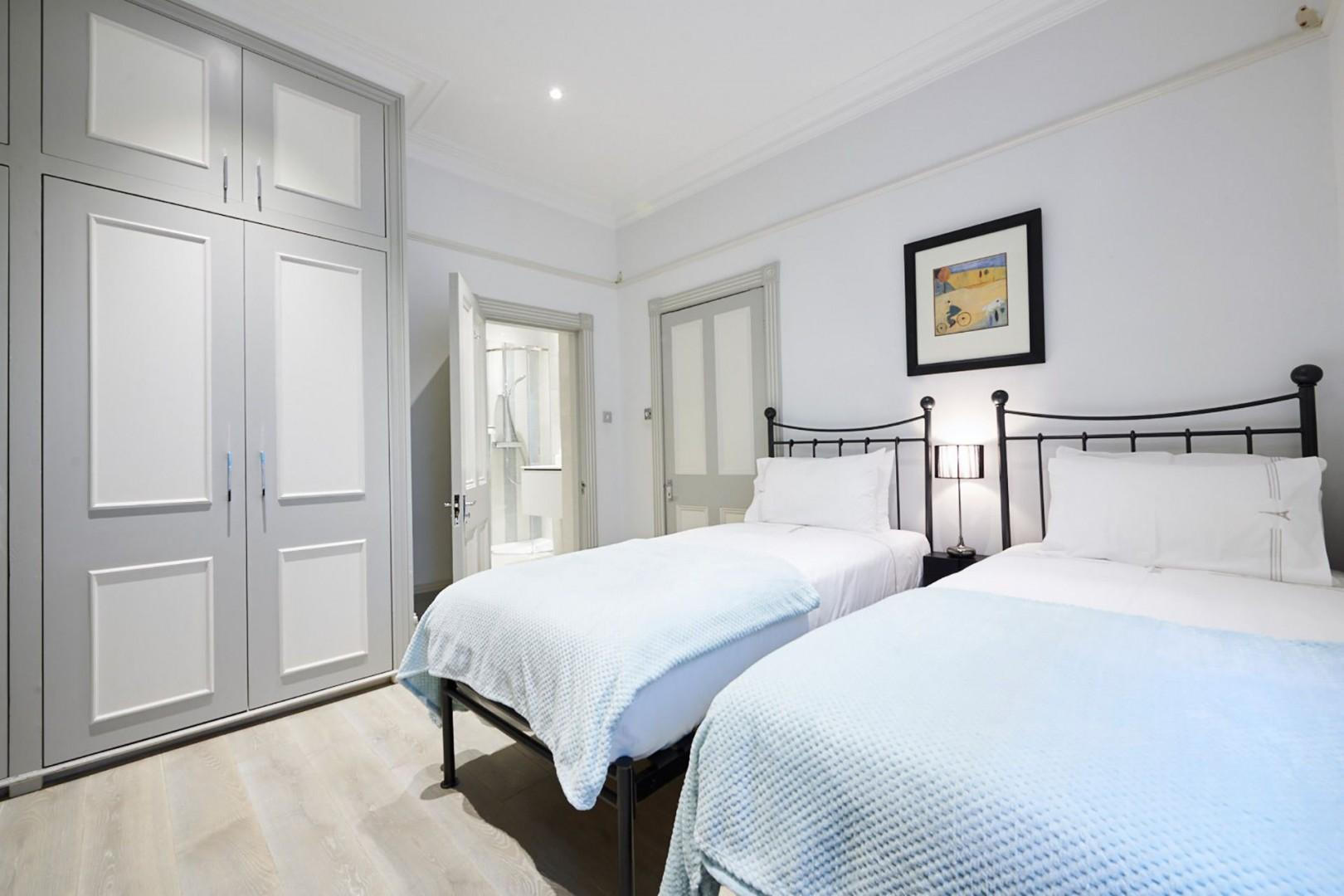 Beautiful bedroom 2 features two comfortable beds