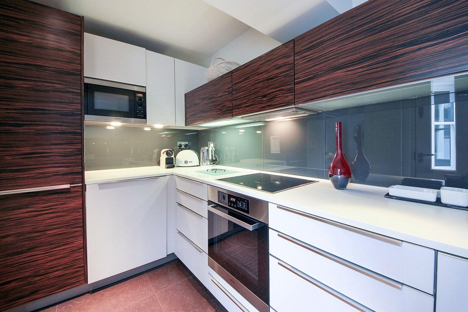 Beautifully designed modern kitchen with teak cabinets
