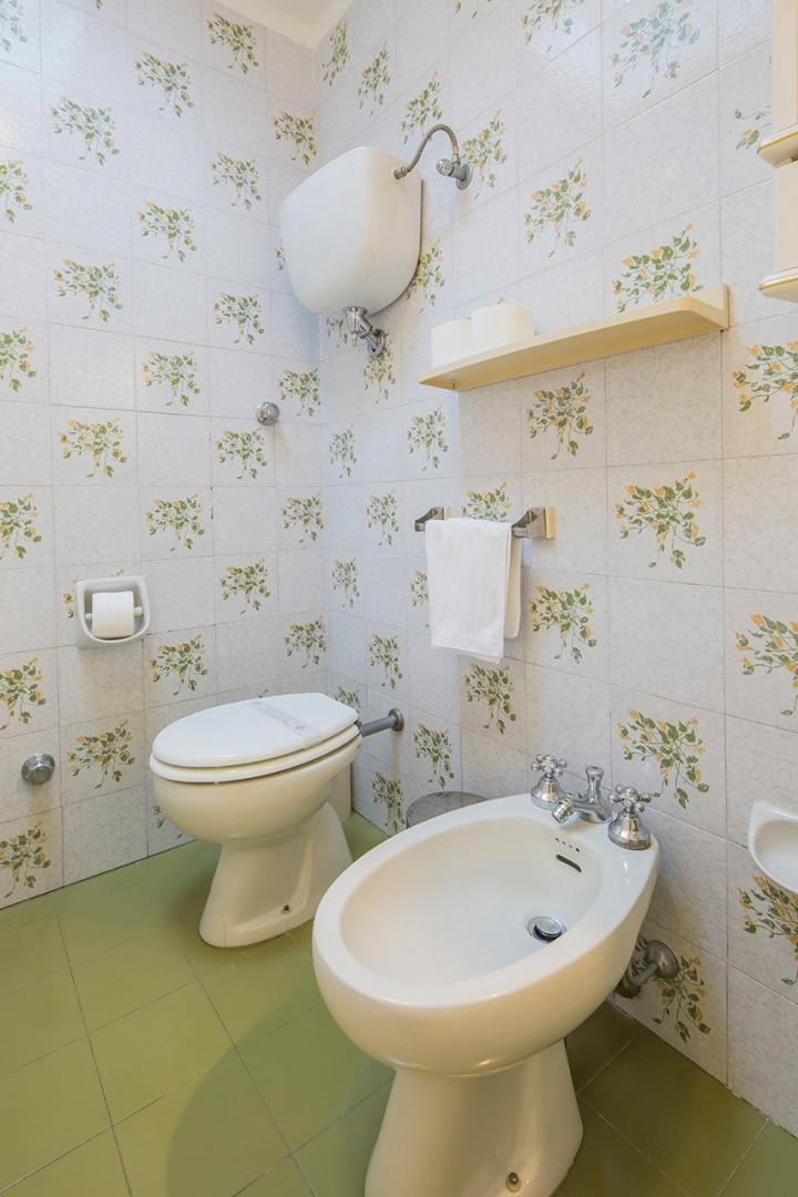 En suite bathroom to bedroom 5 in the apartment.