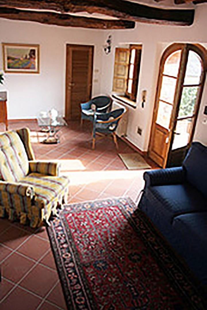Enter from the terrace into a comfortable living room with satellite TV.