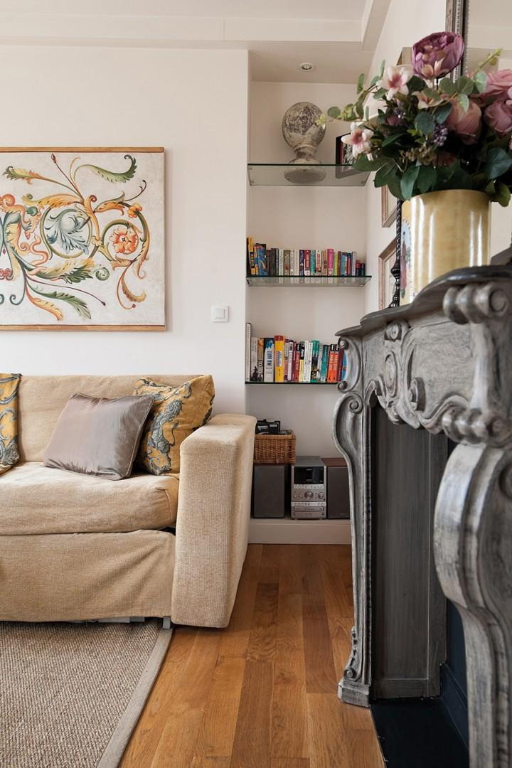 The antique-style fireplace gives the space a regal flair.