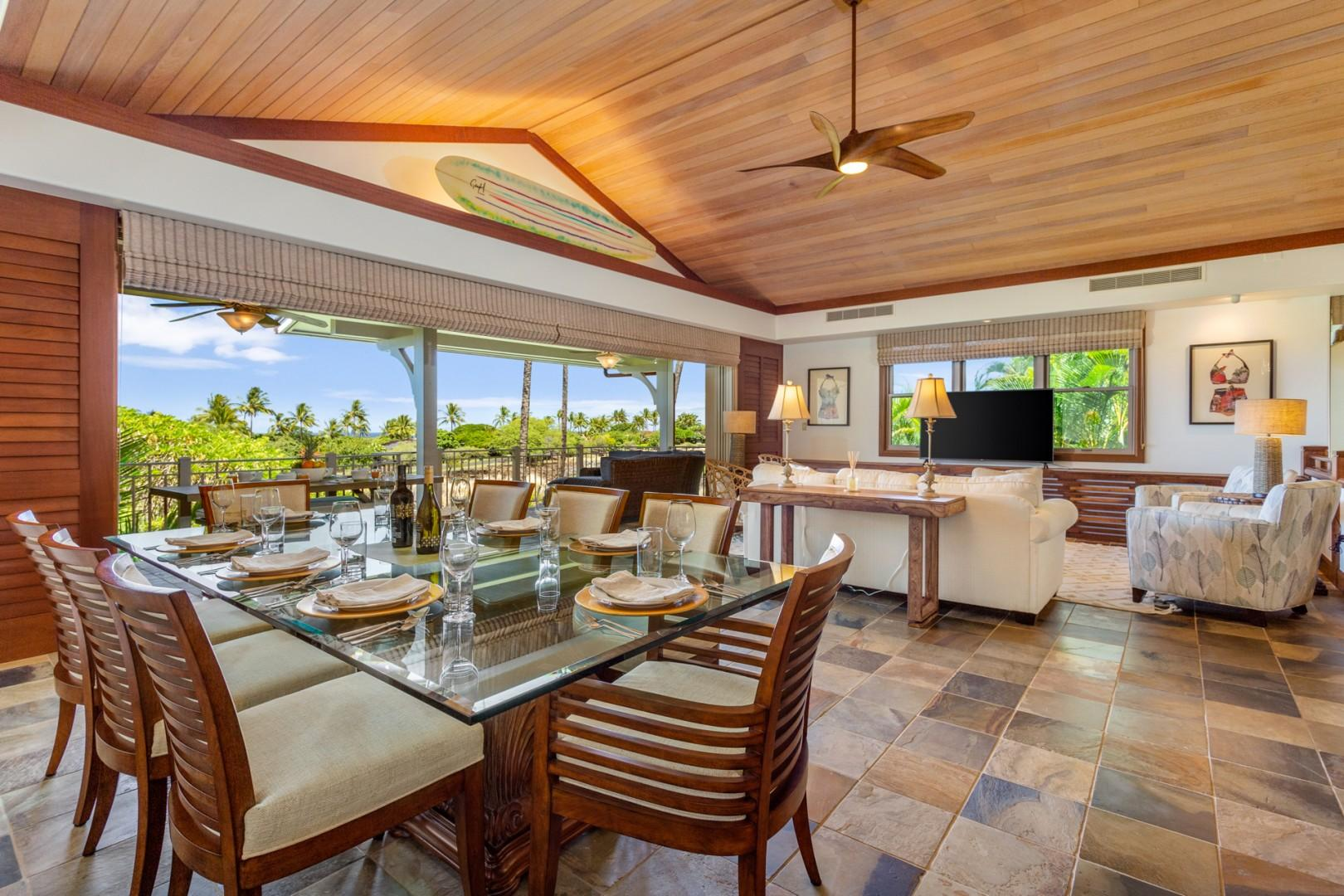 Elegant seating & dining areas, panelled vaulted ceilings and disappearing pocket doors to the upper lanai.