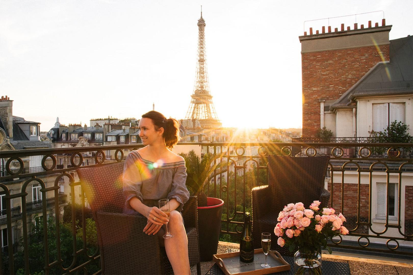 Toast to your Paris vacation on your private balcony.