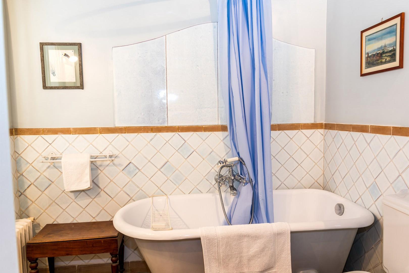Take a soak in the beautiful antique claw-footed bathtub.