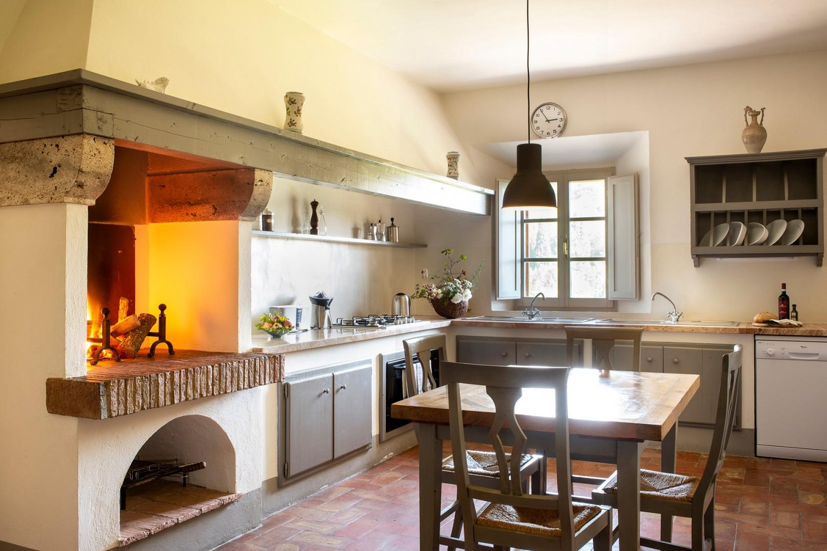 The large kitchen has room for a table for preparation or casual dining.