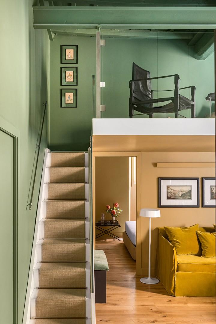 This flight of stairs leads to a loft which has 2 single futons.