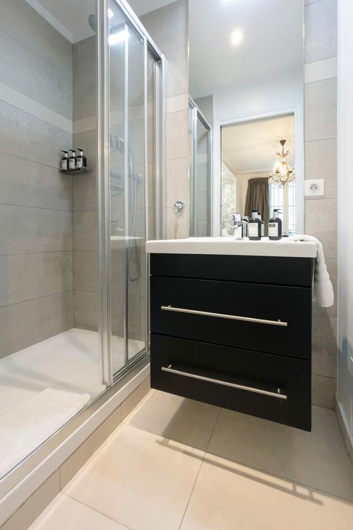 Bathroom 2 is en suite with shower and sink