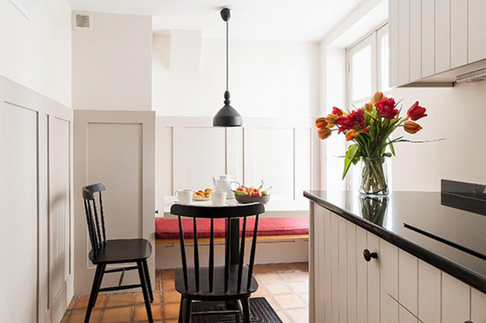 The dining area features a clever built-in bench seat.