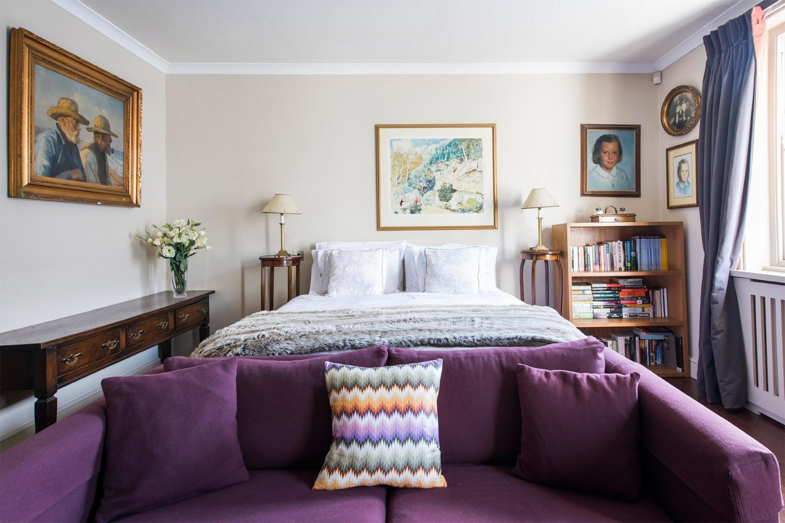 Comfortable first bedroom with a luxurious bed
