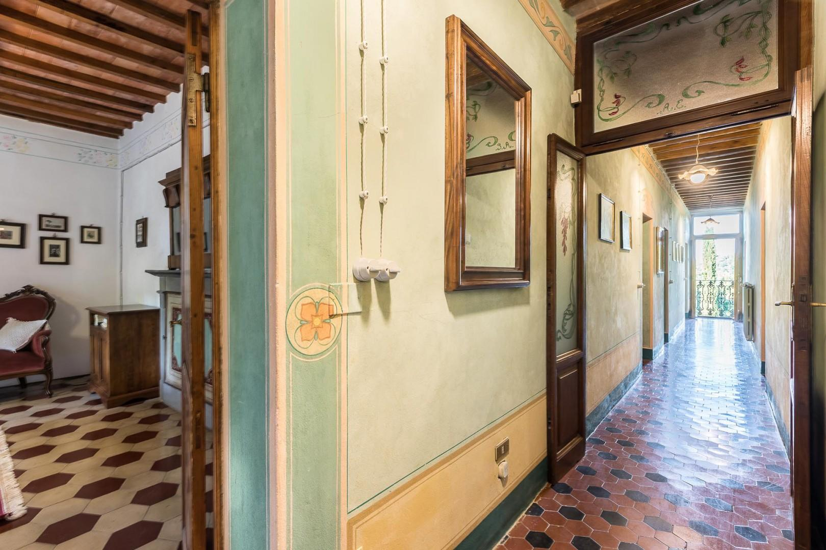 Tiled hallway on the 2nd floor with a French balcony door at the end with beautiful views.
