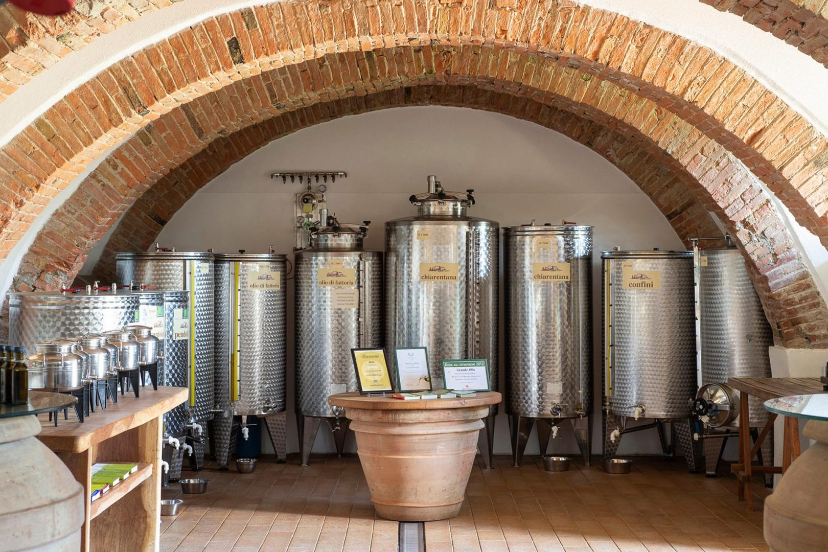 Vats of different olive oils.