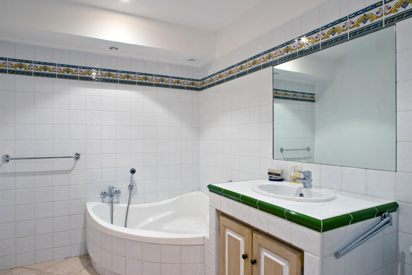 En suite bathroom 4 to bedroom 6 with large bath and sink