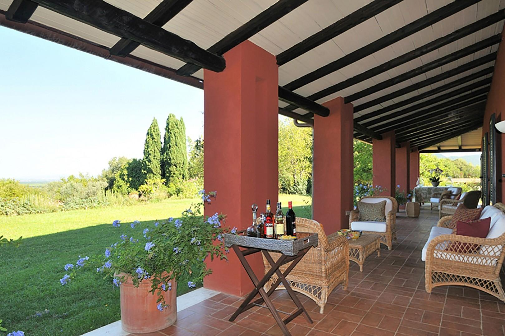 Under the loggia, comfortable rattan chairs.