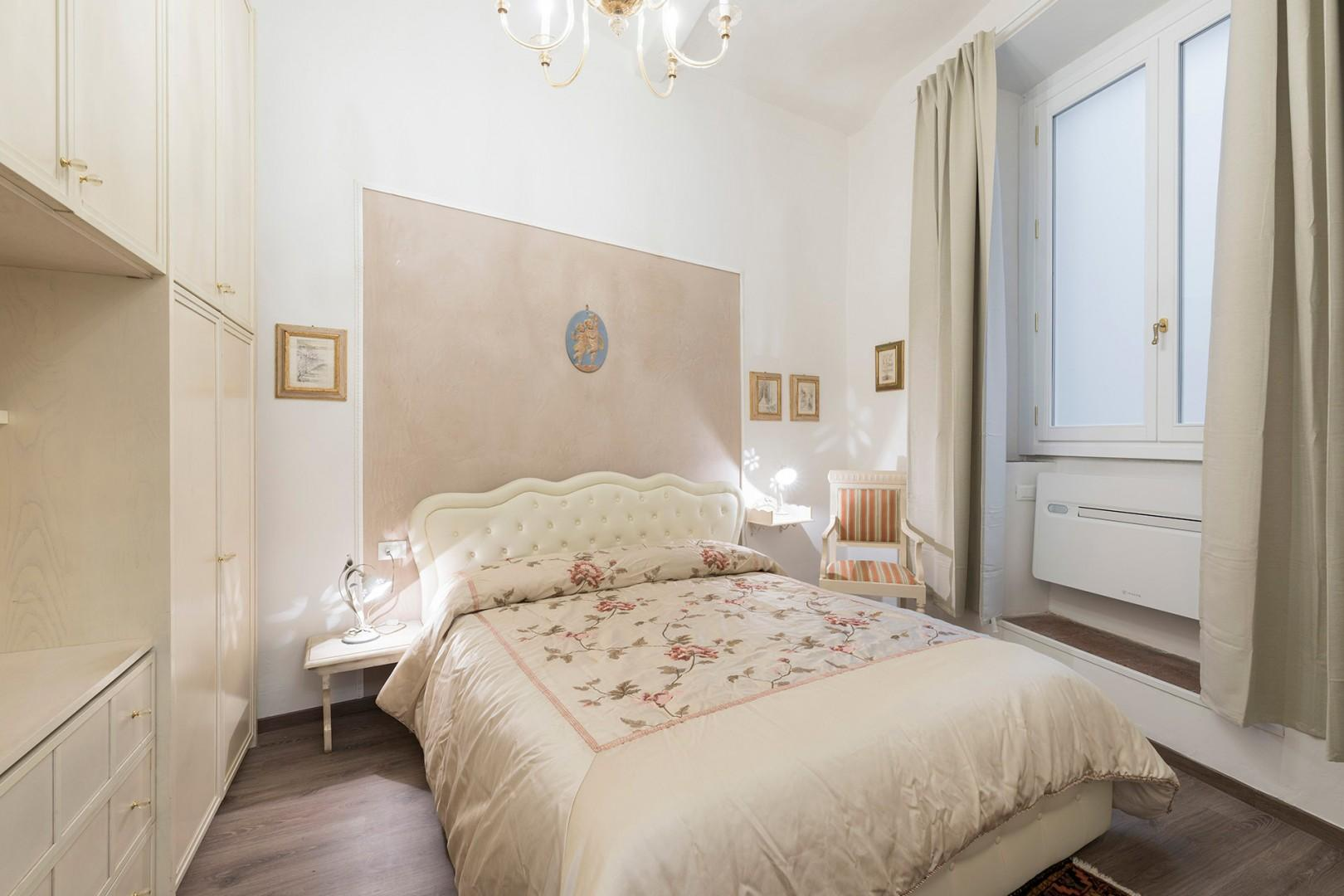 Elegantly furnished bedroom 1 has a large plush bed.