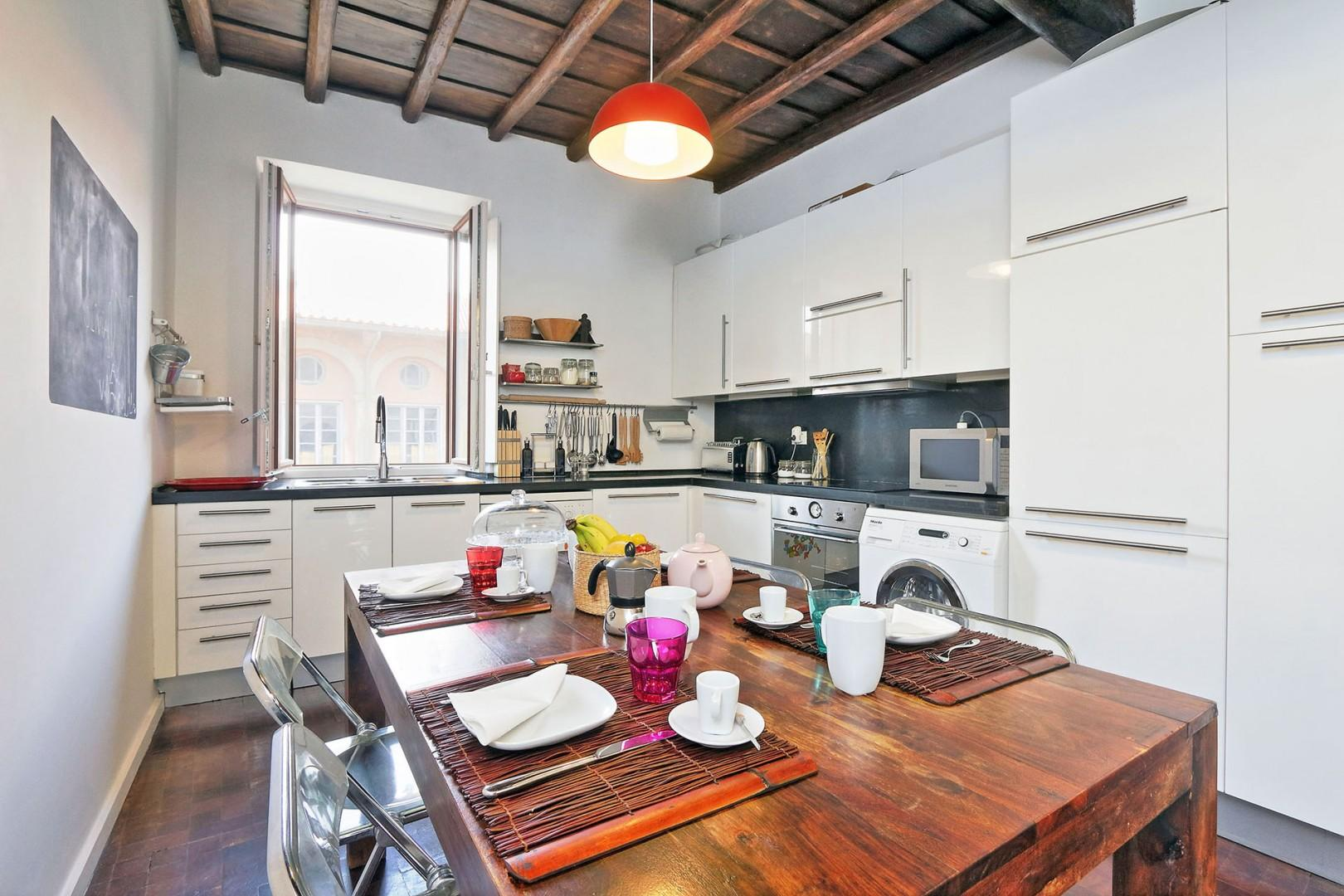 Pretty beamed ceilings enhance the ambiance of the kitchen.