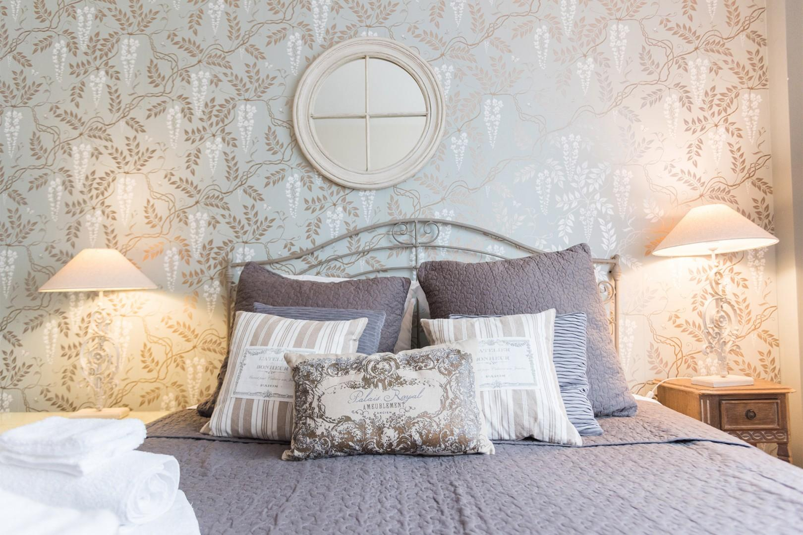 You will love the tasteful decor and French touches in the bedroom.