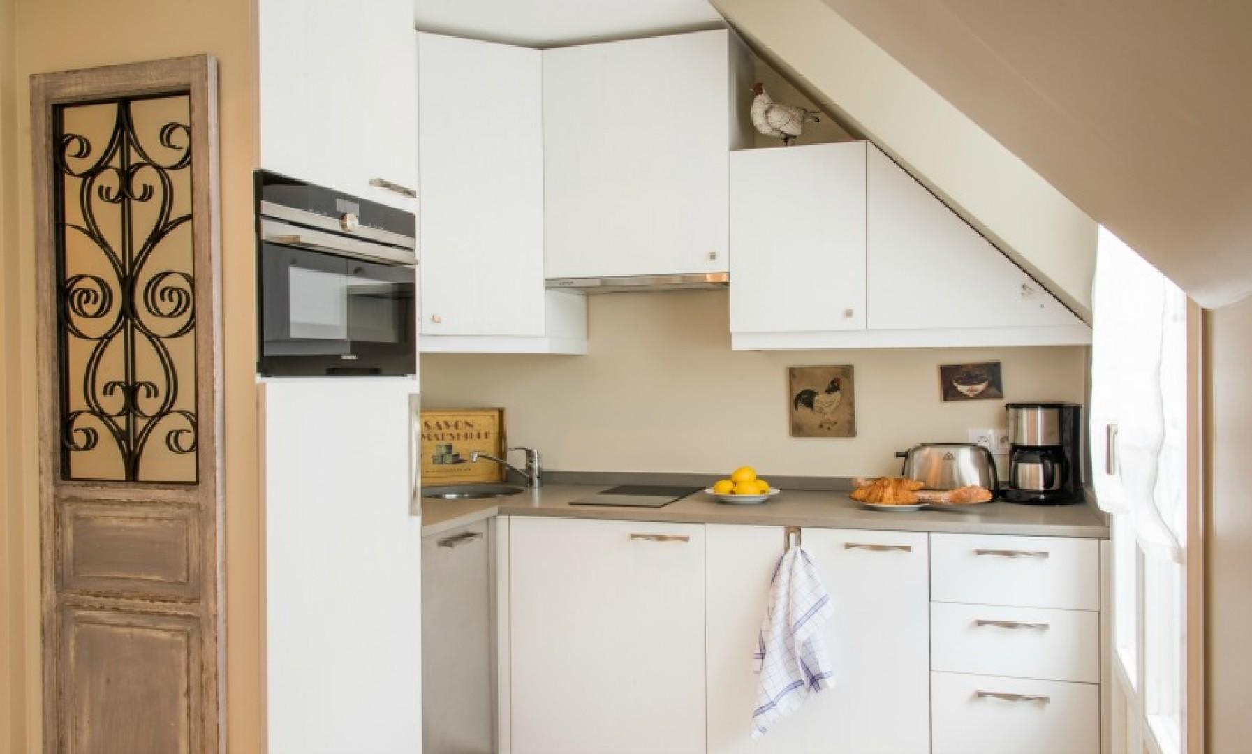 The kitchen is polished and easily accessible.