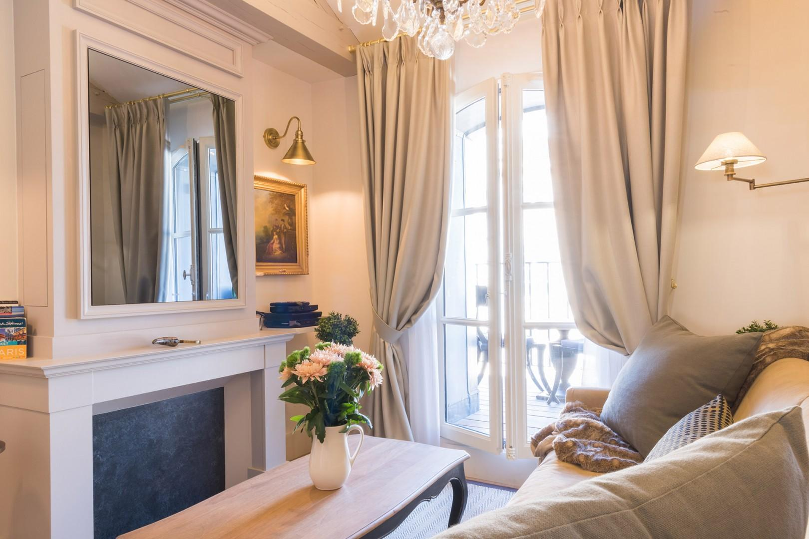 The large French window lets in lots of natural light.