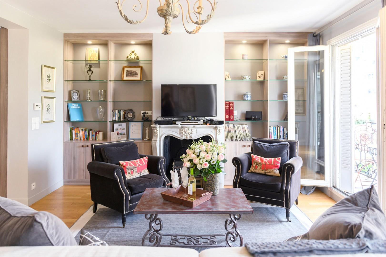 Relax by the charming Parisian fireplace.