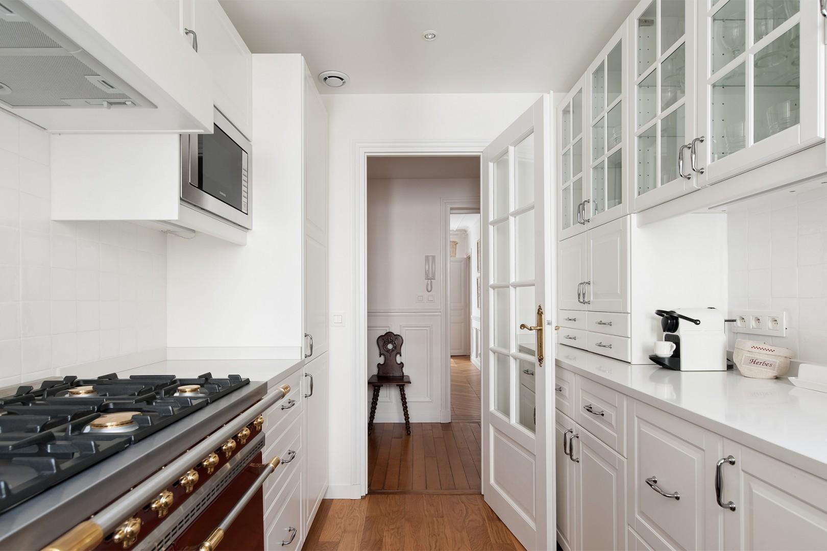 The kitchen features a vintage-style gas stove top and oven.