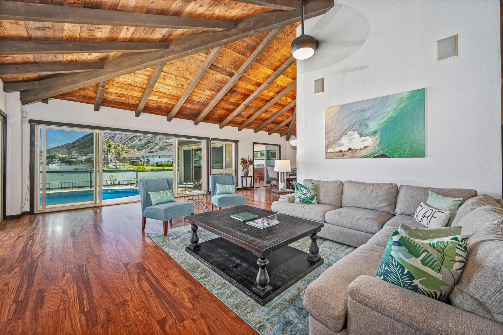 Main living room with pool and stunning marina views.