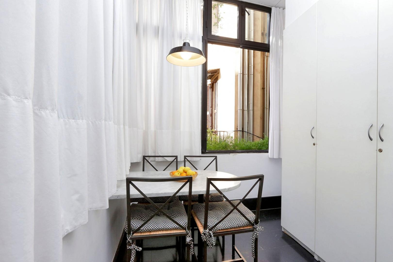 Cheerful breakfast nook has a table and chairs for 4.