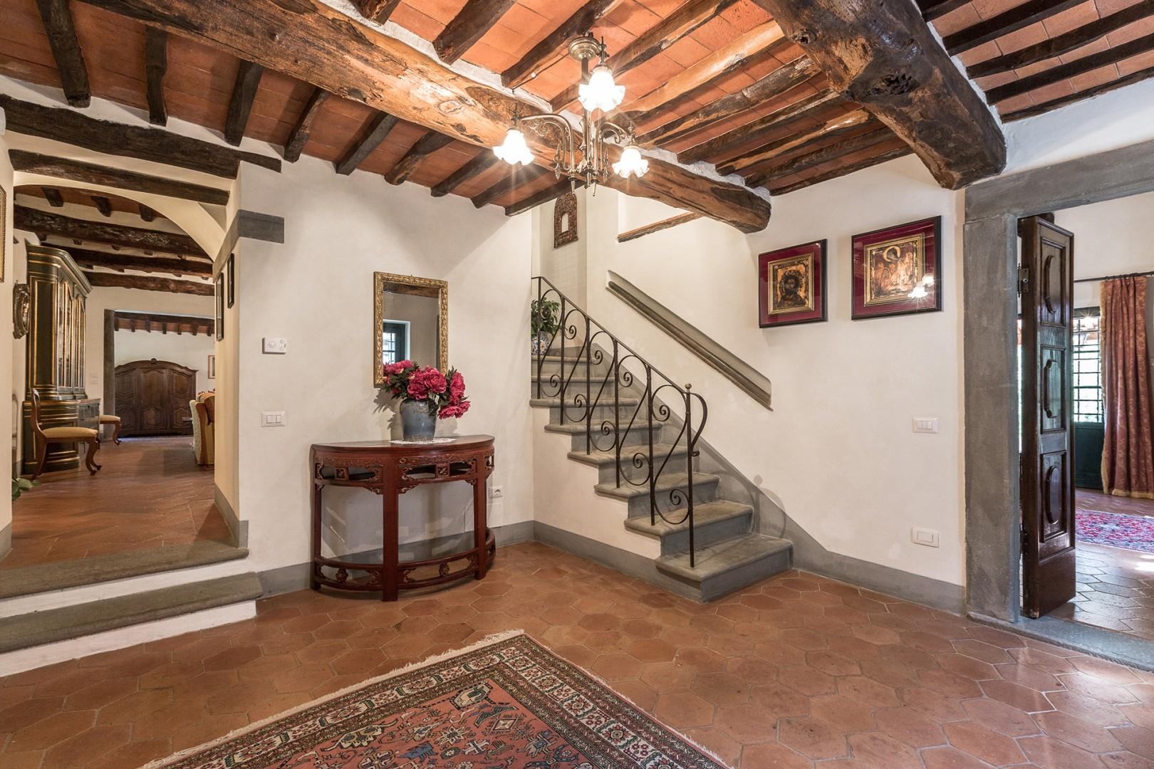 Entry foyer with handsome terra-cotta tiles.