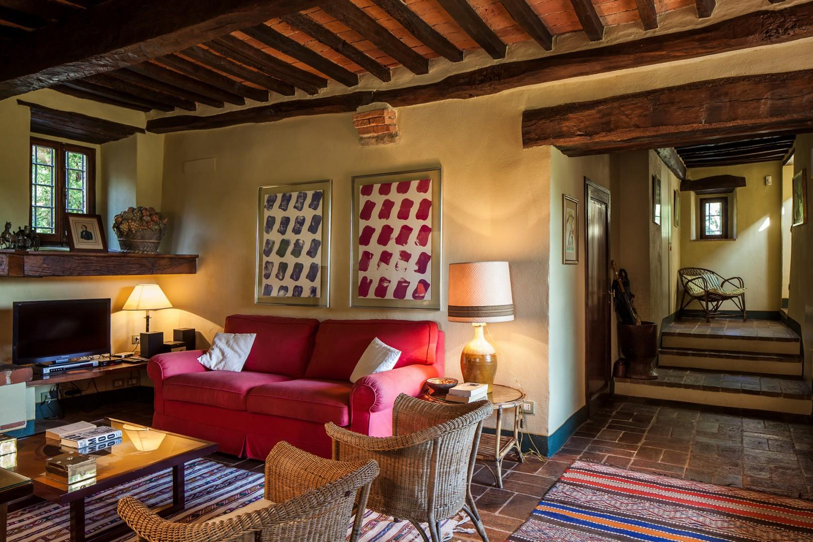 Eclectic artwork, kilim carpets and fabulous beamed ceilings add interest and architectural charm.