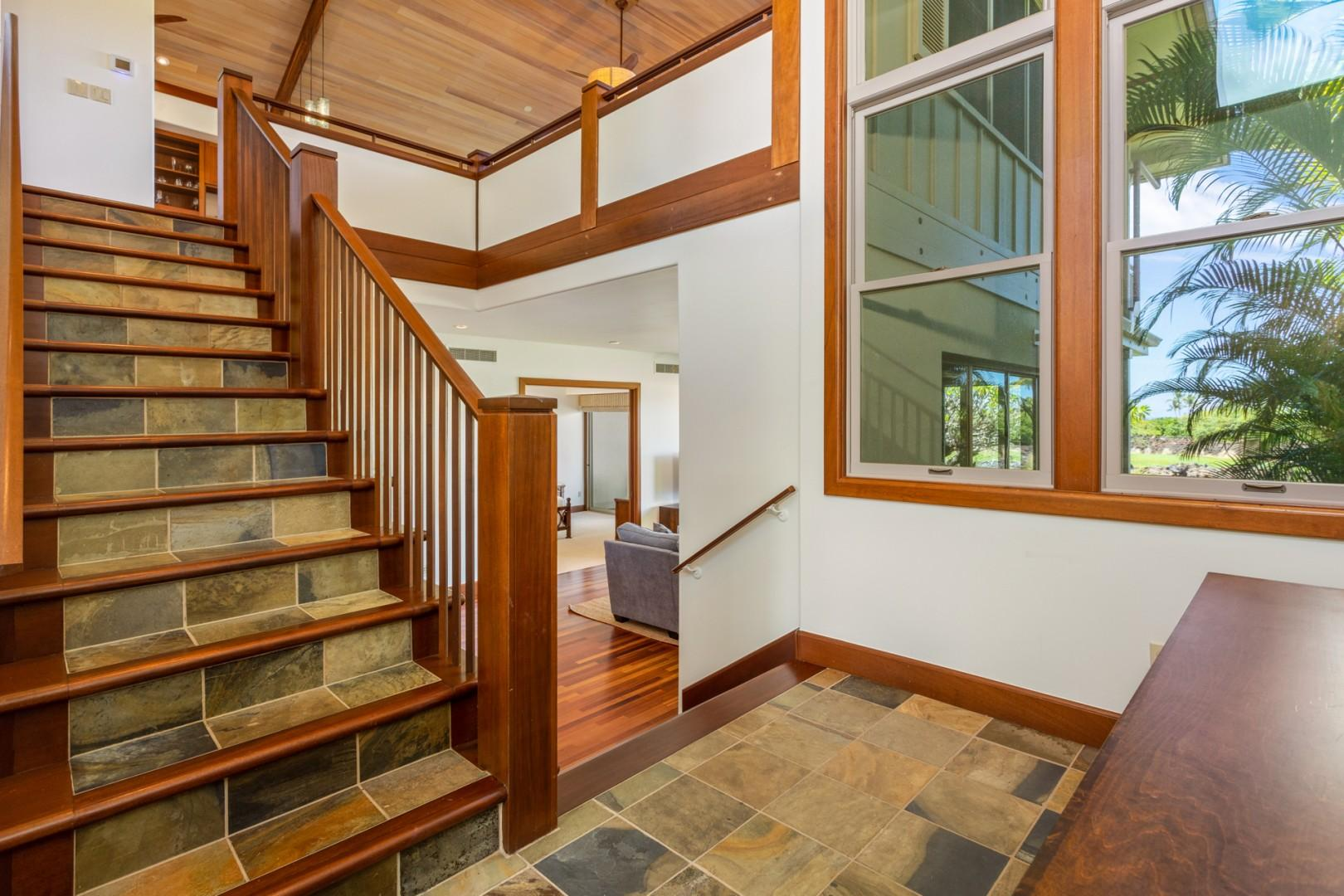 Stately entryway reveals stairways to the upper and lower levels.