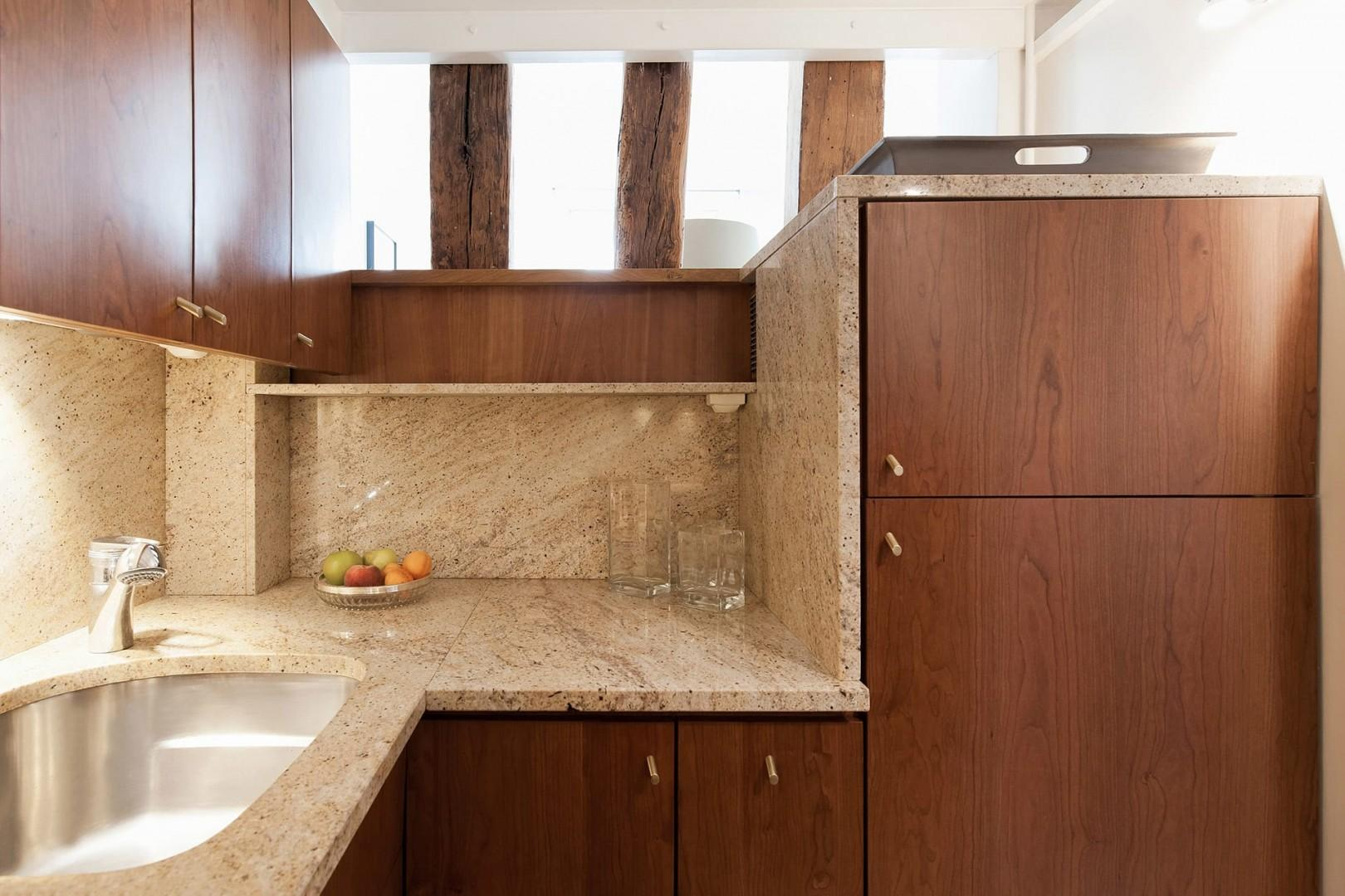 The kitchen can be easily accessed from the living area.