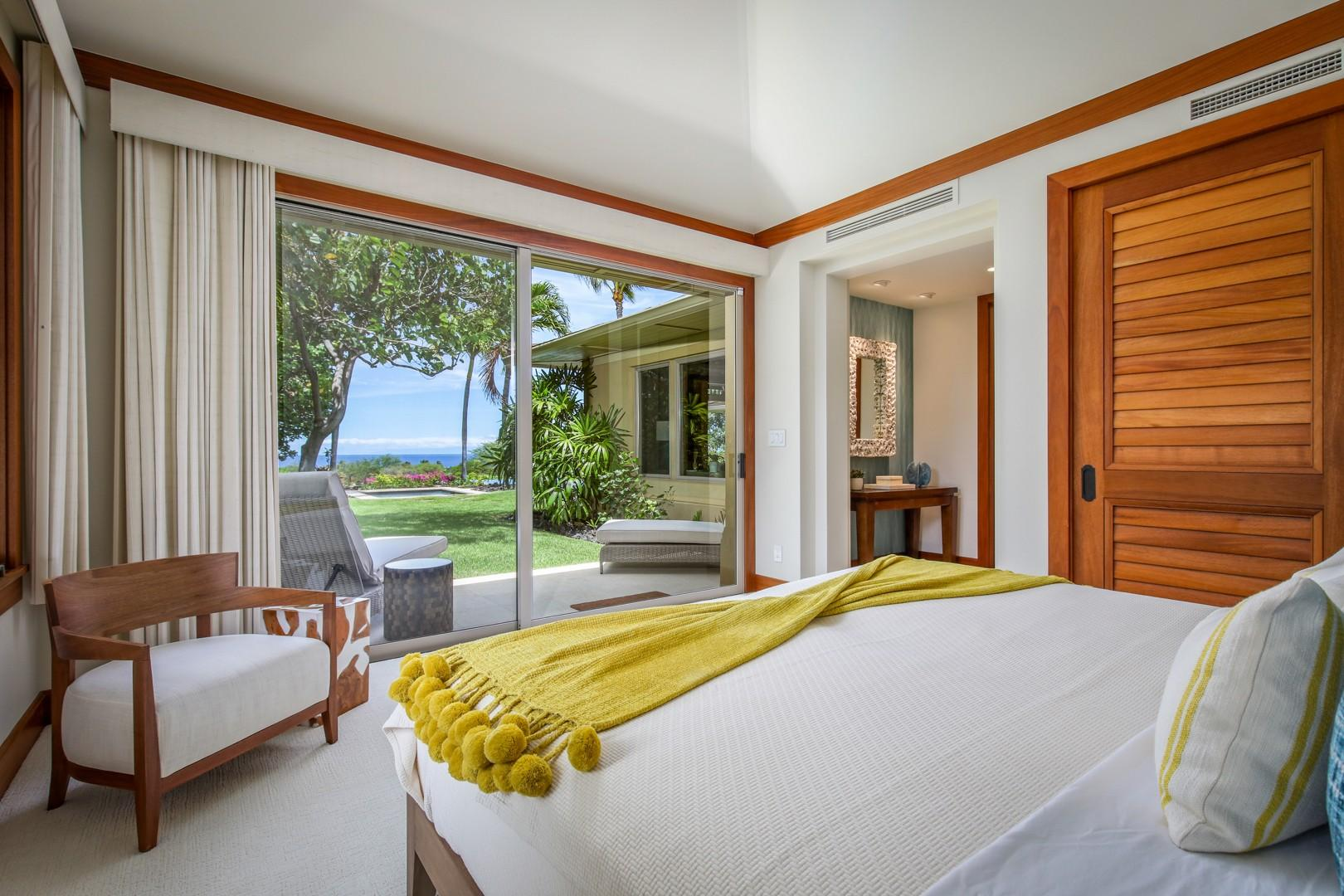 Reverse view of Guest Room 2 showcasing ocean views and private lanai with lounge seating.