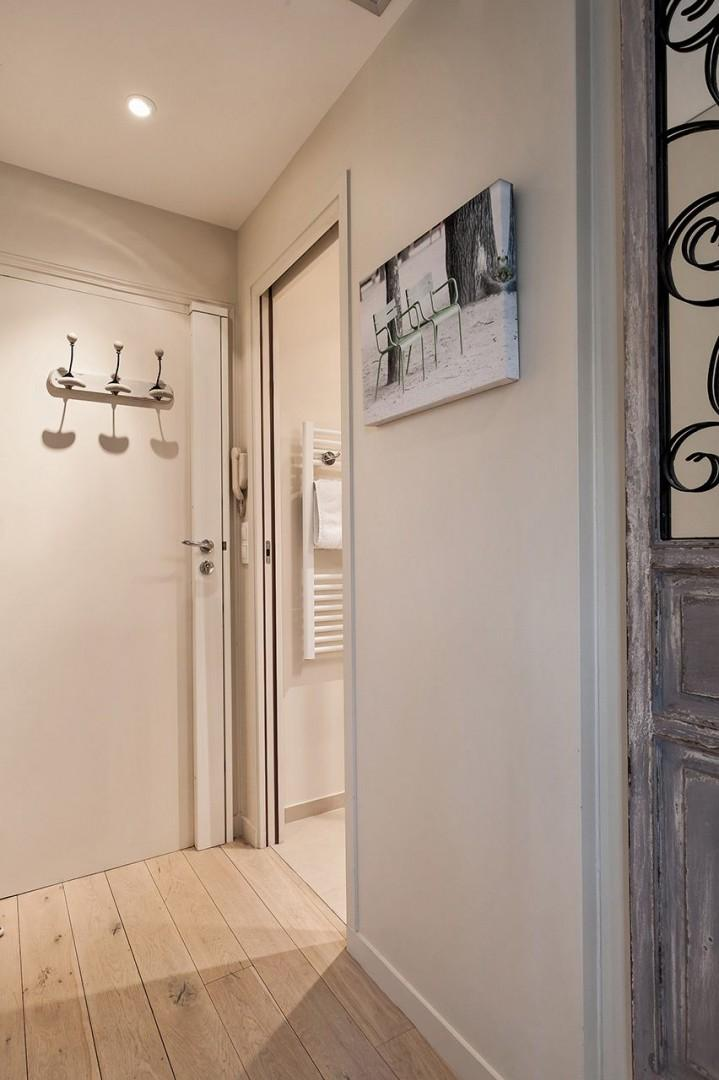 Front door with bathroom immediately to the left
