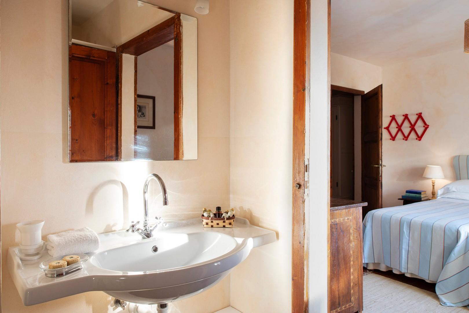 Bathroom en suite to bedroom 2 with shower and sink.