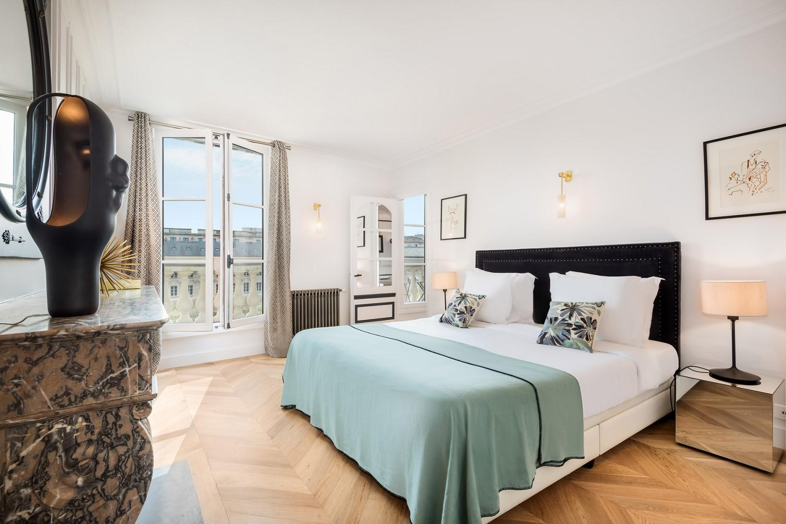 The spacious bedroom 1 is modern and elegantly furnished.